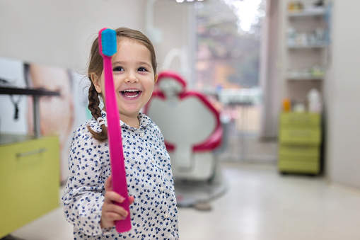 a smiling patient at their first visit at Fircrest Children's Dentistry
